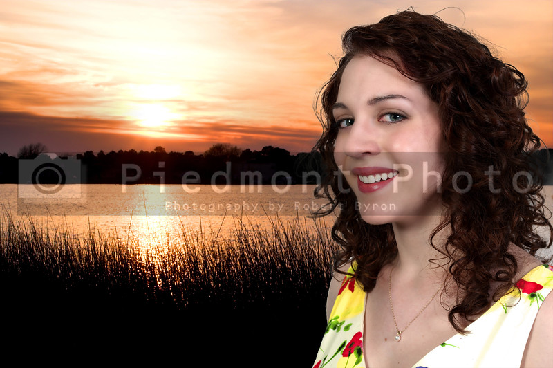 A beautiful sexy young woman at the beach at sunset or sunrise