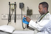 An black man African American doctor holding a syringe