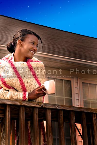 A beautiful young woman enjoying her morning coffee