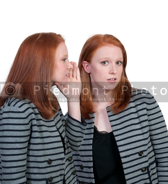A young beautiful woman whispering a secret