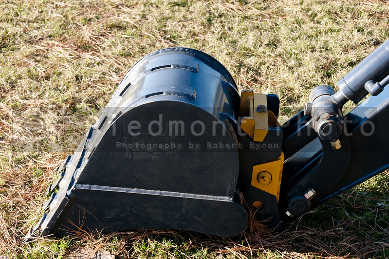 A new modern backhoe shovel in a field
