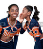 A young beautiful African American cheerleader whispering a secret
