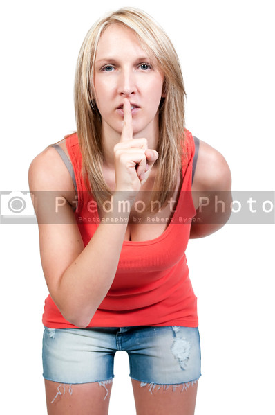 A woman saying be quiet by saying shhh