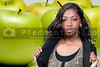 A beautiful African American teenage girl and Granny Smith green apples