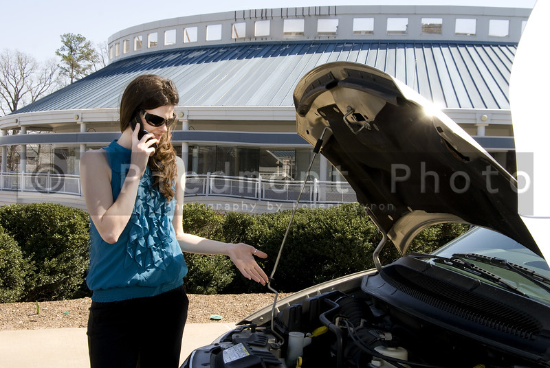 A woman with car trouble calling for help