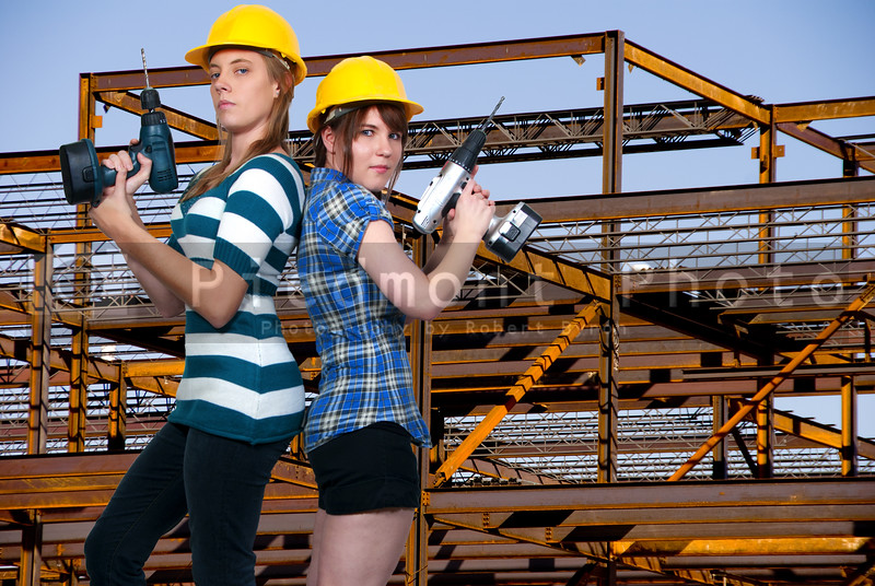 A couple of Women Construction Workers on a job site.