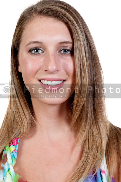 A beautiful young woman posing for her picture