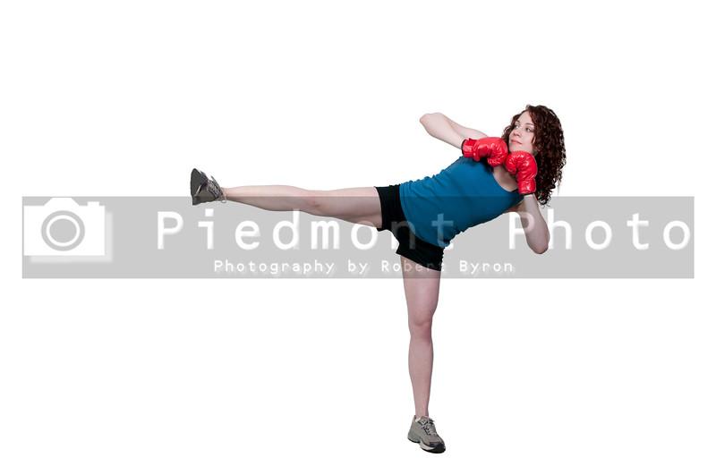 A beautiful young woman practicing martial arts kickboxing