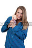 A young Beautiful Woman playing with a baby doll