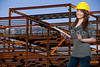 A Female Construction Worker on a job site wearing a hard hat