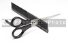 A pair of hair scissors and a comb