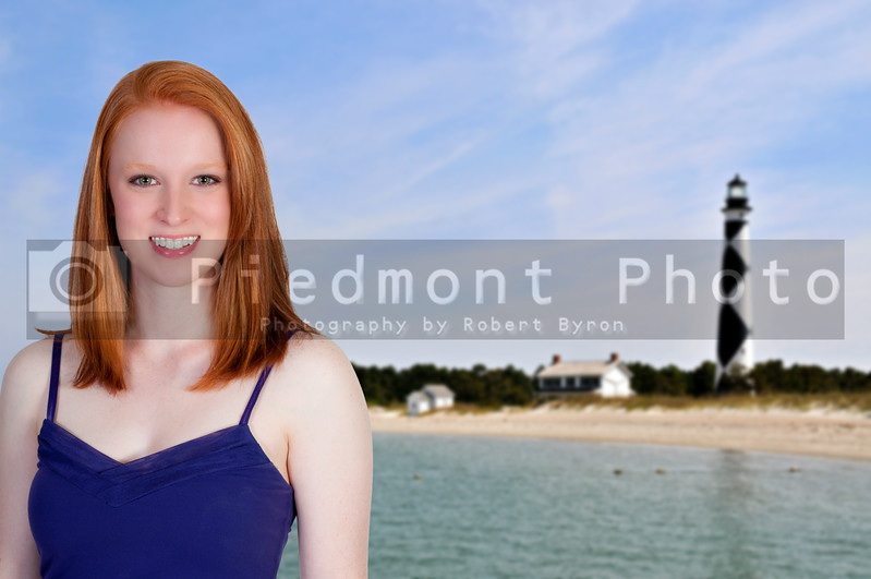 A beautiful sexy young woman at the beach at a lighthouse