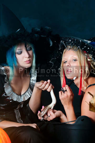 Beautiful young women witches with a snake