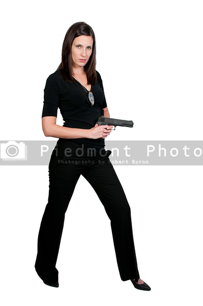 A beautiful police detective woman on the job with a gun