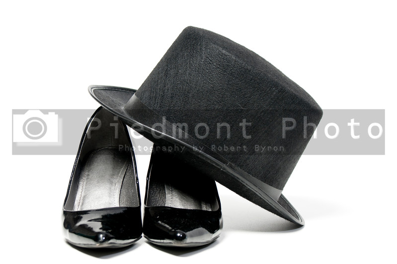 A pair of womens high heel shoes and a top hat