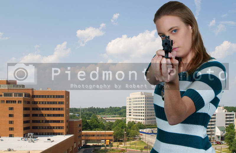 A beautiful police woman on the job with a gun