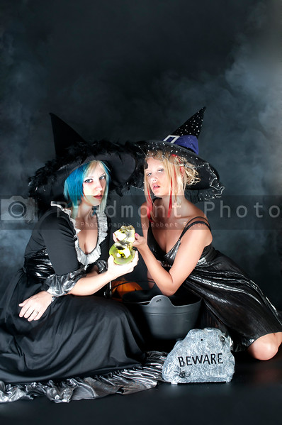 A couple of beautiful young women witches on Halloween