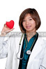 An Asian female cardiologist holding a red heart
