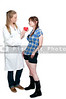 A female cardiologist holding a red heart