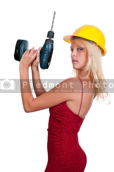A Female Construction Worker holding a cordless drill