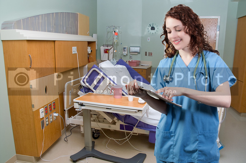 A beautiful young woman doctor or nurse holding a patient record