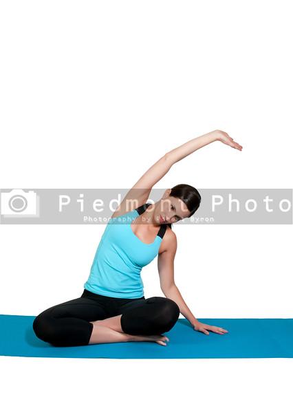 A beautiful woman doing her Yoga lotus position execises