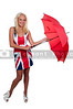 A beautiful woman holding a colorful red umbrella