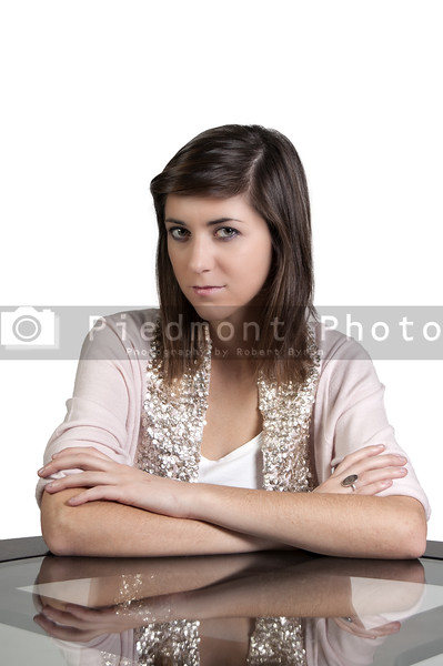 A beautiful young woman looking far away