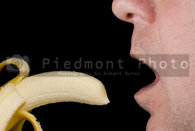 A man eating a fresh and delicious banana