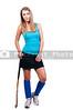 A beautiful young woman field hockey player