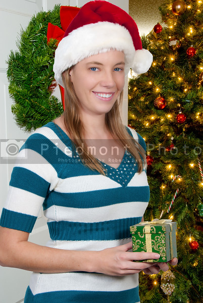A beautiful woman holding a Christmas gift present
