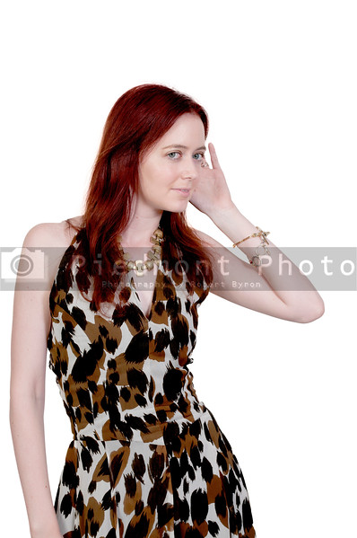 A young beautiful woman eavesdropping on a secret