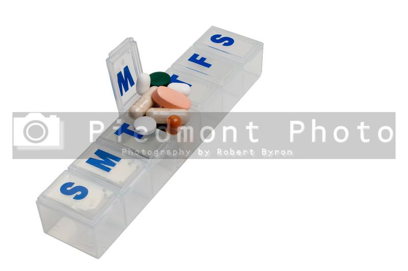 Prescription pills in a medicine dose box