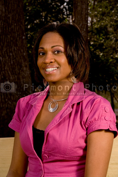 A portrait of a young black woman smiling