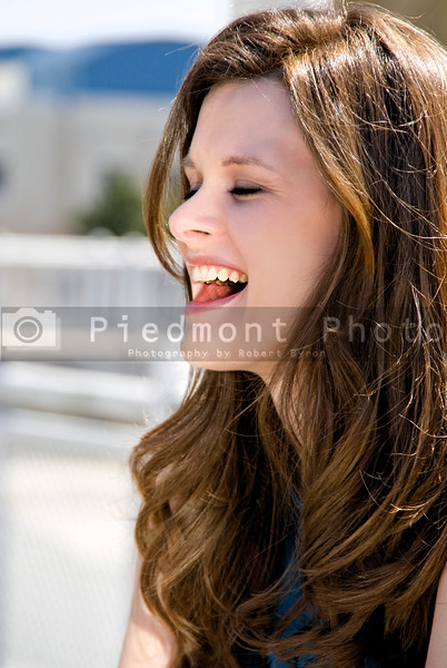 A young Beautiful Woman with a lovely smile laughing