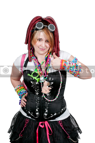 A young woman dressed to go to a rave party dance giving a thumbs up sign