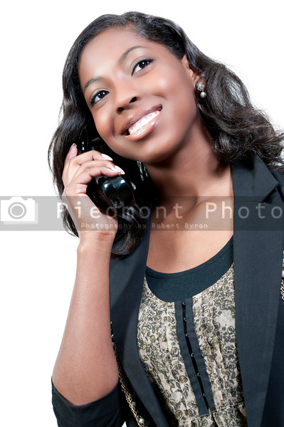 An African American teenage woman talking on the phone