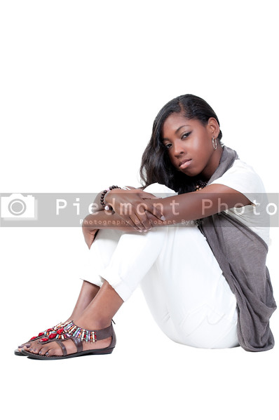 A beautiful young teenage African American woman suffering from the mental illness of depression
