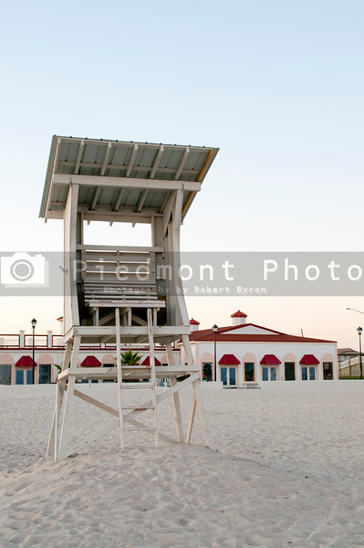 A towering lifeguard station on a sandy beach