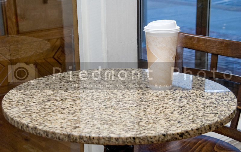 A cup sitting on the table of a Coffee House