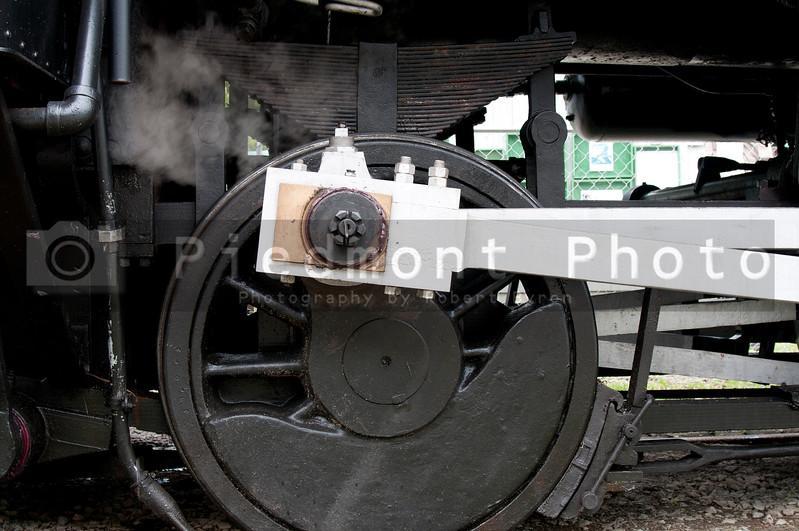 The wheels of a railroad train railcar