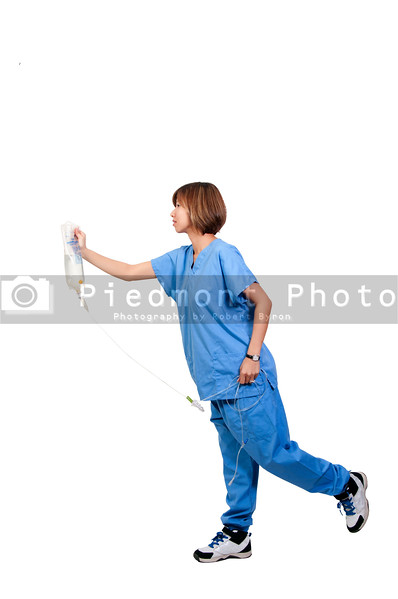 A beautiful young female doctor holding an IV bag