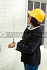 A female Construction Supervisor inspecting a new building