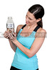 A beautiful woman holding her retirement account of coins in a milk bottle