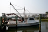 A commercial shrimp boat docked at the ocean