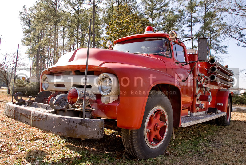 An old vintage antique firetruck ready for action