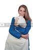 A beautiful young woman wearing pajamas hugging her pillow
