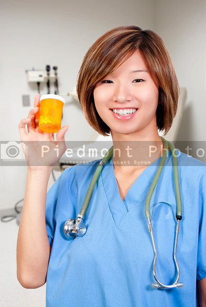 A beautiful young female doctor on her rounds