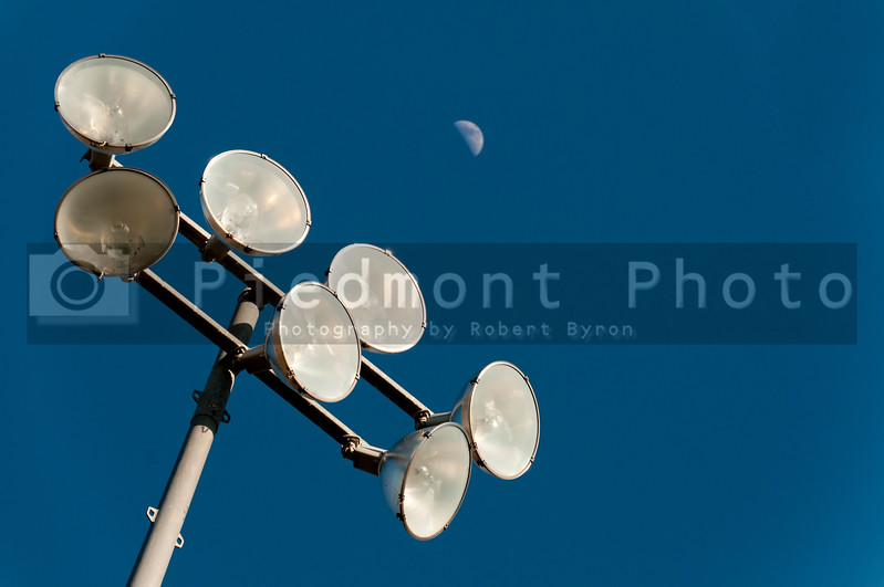 A set of stadium lights over a sports field