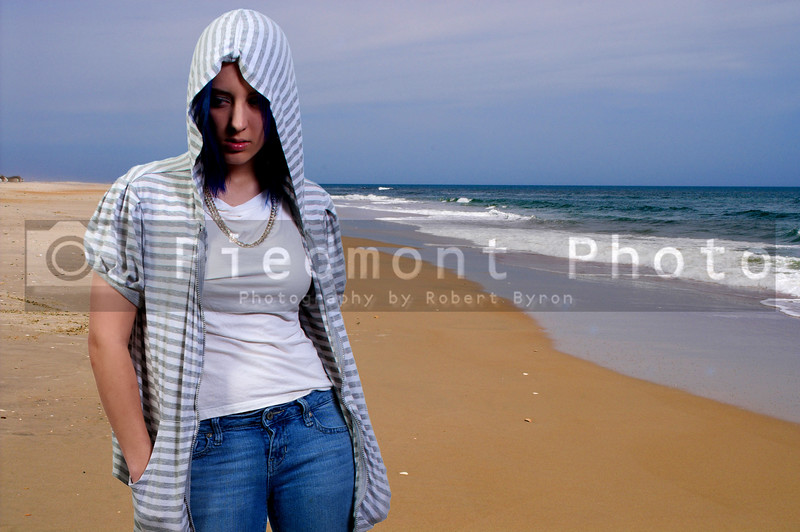Beautiful younf woman walking on a sandy tropical paradise known as the beach.